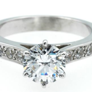 1012-Platinum-six-claw-1.00ct-diamond-solitaire-with-pave-shoulders.jpg